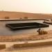 Une scene hydrolique a 3 niveaux entouree d'un lac au milieu du desert